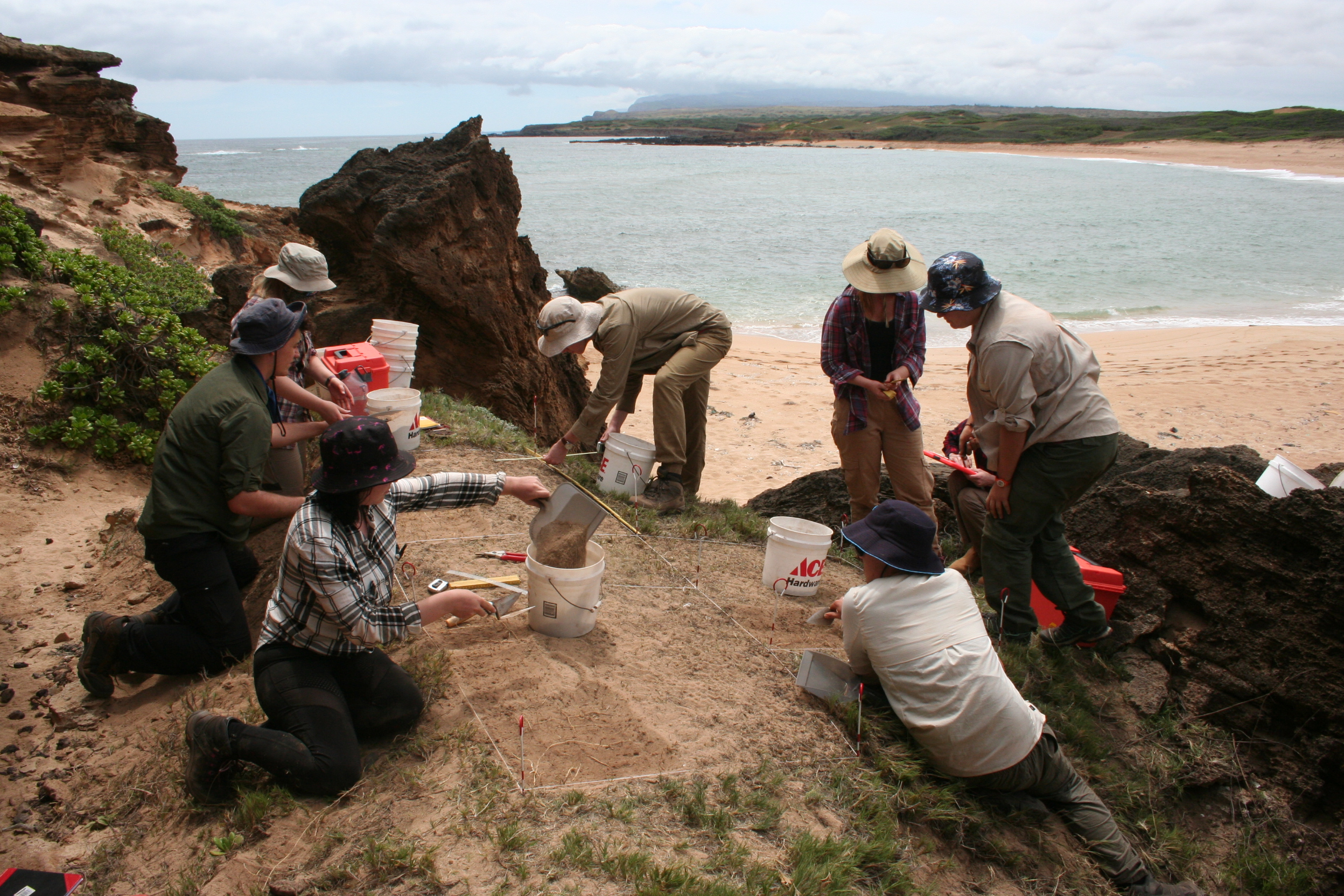 UQ students excavating an ancient site just above a pristine beach along the rugged, windward coast of Moloka'i, Hawaiian Islands.